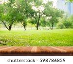 empty brown plank wood table... | Shutterstock . vector #598786829