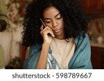 serious young dark skinned... | Shutterstock . vector #598789667