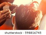 the barber cuts hair man with a ... | Shutterstock . vector #598816745