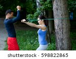 personal trainer showing his... | Shutterstock . vector #598822865