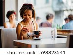young black woman texting in... | Shutterstock . vector #598828541