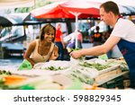 smiling black woman buying... | Shutterstock . vector #598829345