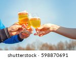 clinking glasses of beer on the ... | Shutterstock . vector #598870691