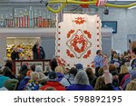 Small photo of GORDONVILLE PENNSYLVANIA - March 11, 2017: Amish volunteers help at the annual quilt auction which benefits the Fire Company.
