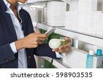 businesswoman scanning product... | Shutterstock . vector #598903535