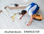 repairman laying laminate... | Shutterstock . vector #598903739