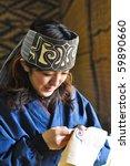 Small photo of HOKKAIDO, JAPAN - NOVEMBER 17 : Ainu Woman sewing in Shiraoi Ainu Museum on November 17,2009 in Hokkaido, Japan. Shiraoi Ainu Museum called Porotokotan, is one of Hokkaido's better Ainu Museums