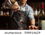sommelier pouring wine into... | Shutterstock . vector #598914629