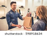 handsome shop assistant is... | Shutterstock . vector #598918634