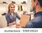 beautiful shop assistant is... | Shutterstock . vector #598919024