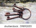 Antique Copper Keys On Old...