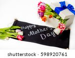 gift for woman with tulips | Shutterstock . vector #598920761