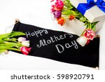 gift for woman with tulips | Shutterstock . vector #598920791
