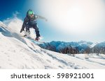 snowboarder is jumping with... | Shutterstock . vector #598921001