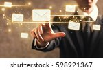 emails with businessman on dark ... | Shutterstock . vector #598921367