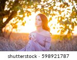 beautiful young woman with cup... | Shutterstock . vector #598921787