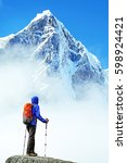 hiker with backpacks reaches... | Shutterstock . vector #598924421