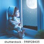 child little girl at the window ... | Shutterstock . vector #598928435
