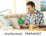 happy student writing in a... | Shutterstock . vector #598946507