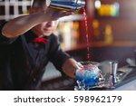 bartender pouring fresh... | Shutterstock . vector #598962179