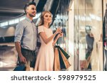 beautiful couple with shopping... | Shutterstock . vector #598979525