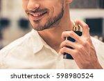 handsome guy is choosing... | Shutterstock . vector #598980524