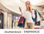 beautiful girl is holding... | Shutterstock . vector #598990925