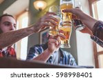 friends cheering with beer... | Shutterstock . vector #598998401