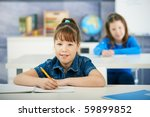schoolgirls sitting at desk in... | Shutterstock . vector #59899852