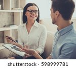 beautiful female psychologist... | Shutterstock . vector #598999781