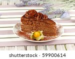 macro of a creamy chocolate cake on a white dish - stock photo