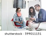 business people discussing in... | Shutterstock . vector #599011151