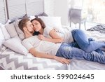 young loving couple in the bed. ... | Shutterstock . vector #599024645