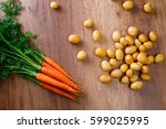 potatoes with carrot. raw new... | Shutterstock . vector #599025995