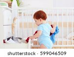 funny infant baby throwing out... | Shutterstock . vector #599046509