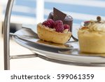 afternoon tea on the deck of a... | Shutterstock . vector #599061359