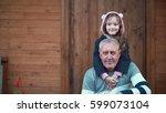 granddaughter standing behind... | Shutterstock . vector #599073104