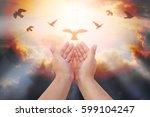 human hands open palm up... | Shutterstock . vector #599104247