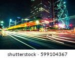 modern urban traffic at night   Shutterstock . vector #599104367