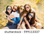 friends in sunglasses taking... | Shutterstock . vector #599113337