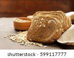 whole grain bread with oat... | Shutterstock . vector #599117777