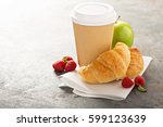 croissants with coffee to go in ... | Shutterstock . vector #599123639