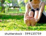 foot pain .woman sitting on... | Shutterstock . vector #599135759