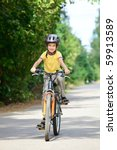 Young Boy Riding Bicycle On A...