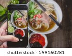 taking a photo by finger... | Shutterstock . vector #599160281