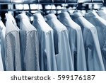 men suits hanging in a clothing ... | Shutterstock . vector #599176187