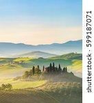 beautiful foggy landscape in... | Shutterstock . vector #599187071