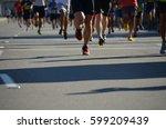 marathon runners legs  | Shutterstock . vector #599209439