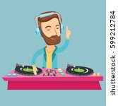 caucasian dj in headphones at...   Shutterstock .eps vector #599212784