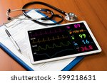 Stock photo vital sign monitor in tablet pc medical technology concept 599218631